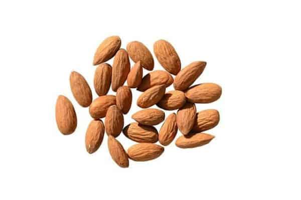 approximately 2 dozen almonds in white background