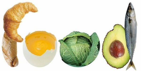 A croissant, an egg, a brussel sprout, an avocado and a fish