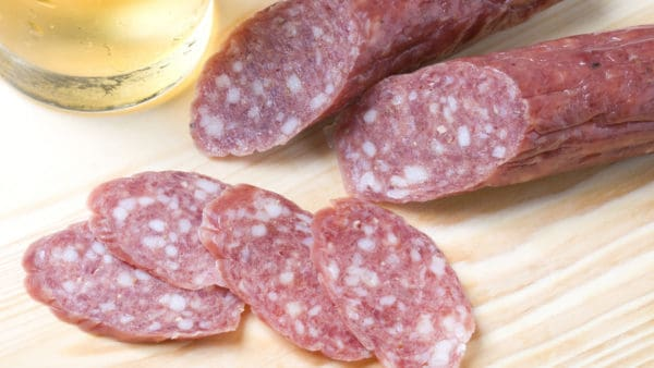 Image of a salami, some of which has been sliced.